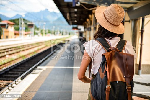 Photo of a female traveler waiting the train