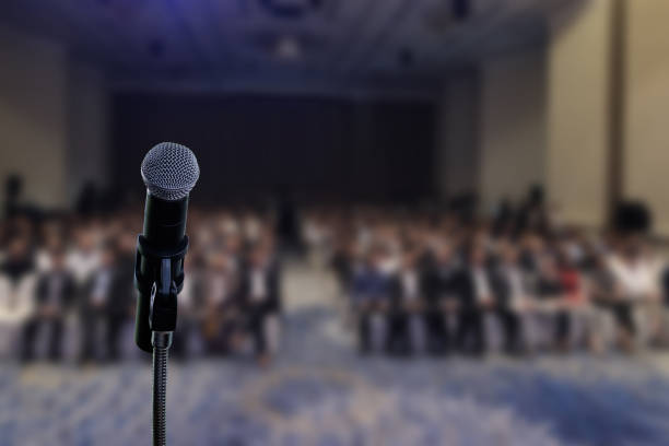 Ready to listen. Microphone in seminar event in meeting room. attending stock pictures, royalty-free photos & images