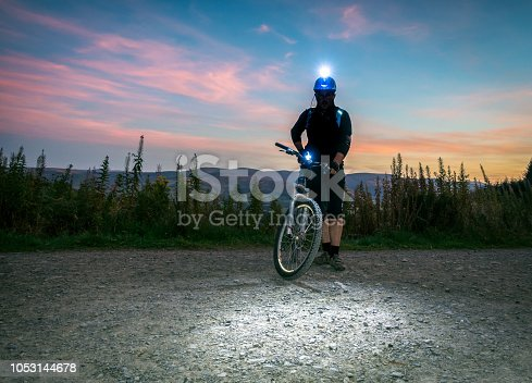 A mountain biker standing ready for the challenge.