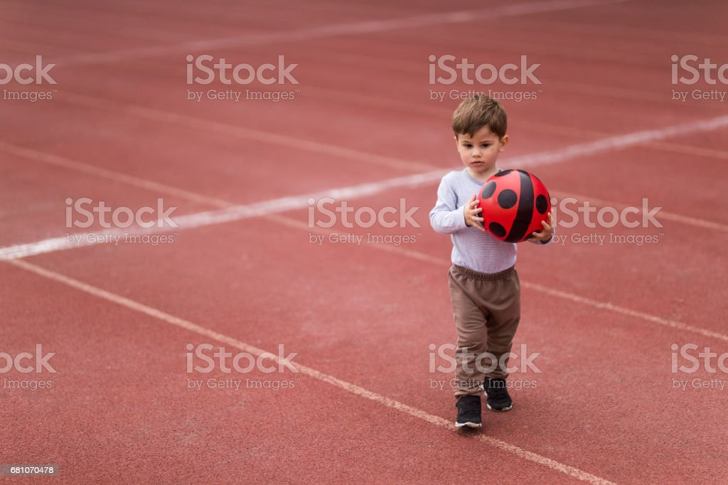 Ready to play with my red ball royalty-free stock photo