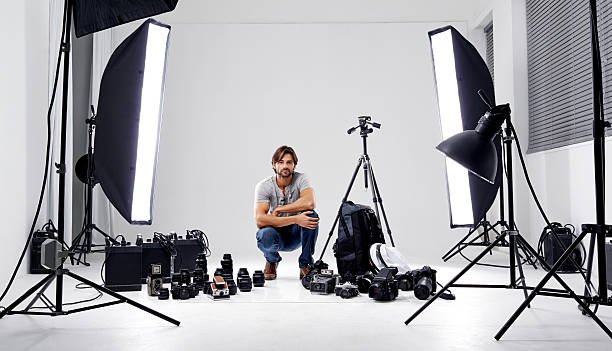 ready to shoot! - camera photographic equipment stock photos and pictures