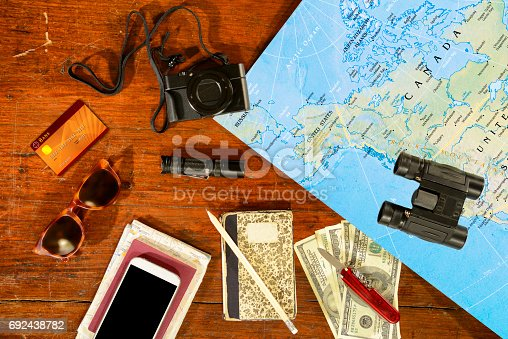 Collection of travel items. The map is in Public Domain at