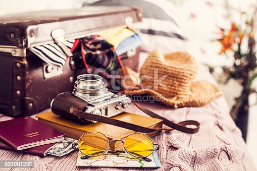 istock Ready vacation suitcase on bed 531001290