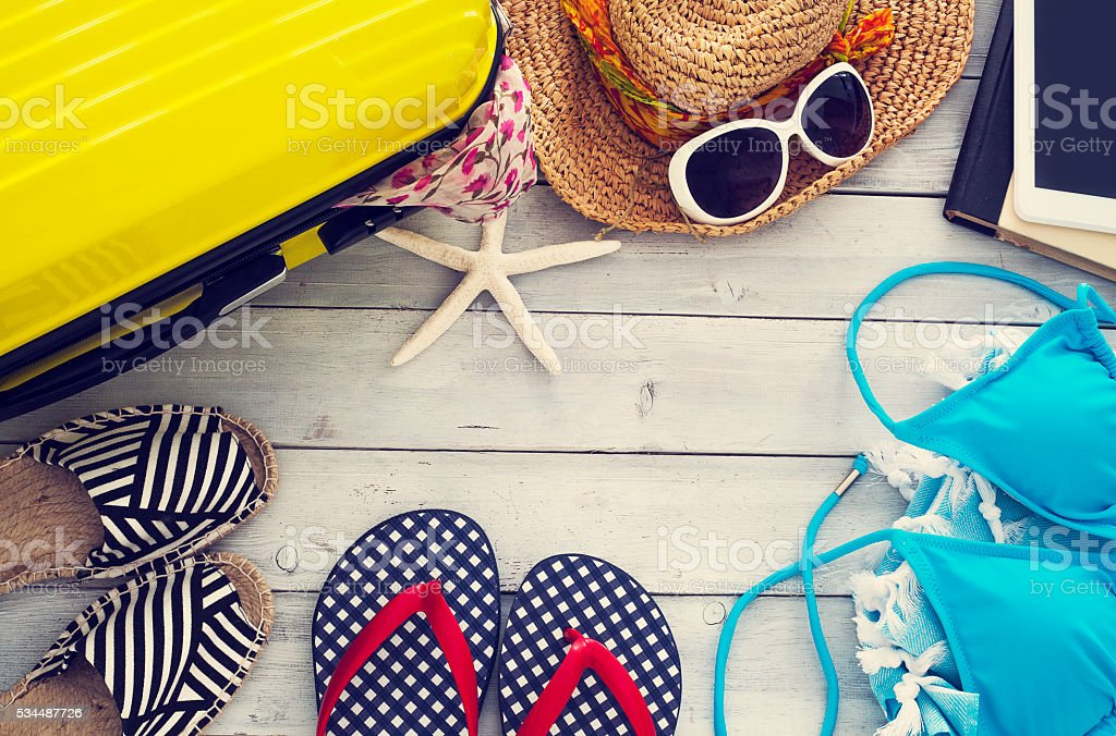 Ready vacation suitcase on wooden background bildbanksfoto