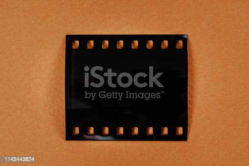 1129542015 istock photo real 35mm film frame or strip on colourful background 1143443824
