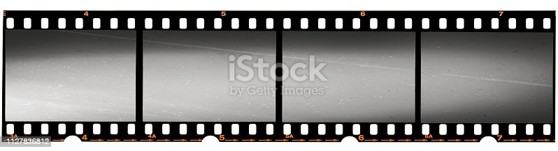1125303139 istock photo real 35mm film strip on white, analogue photo frame placeholder 1127836812