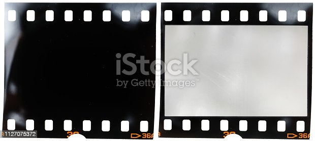 1125303139 istock photo real 35mm film strip on white background with and without blank or empty picture frame, real macro photo of 135 film material, no scan, film texture 1127075372