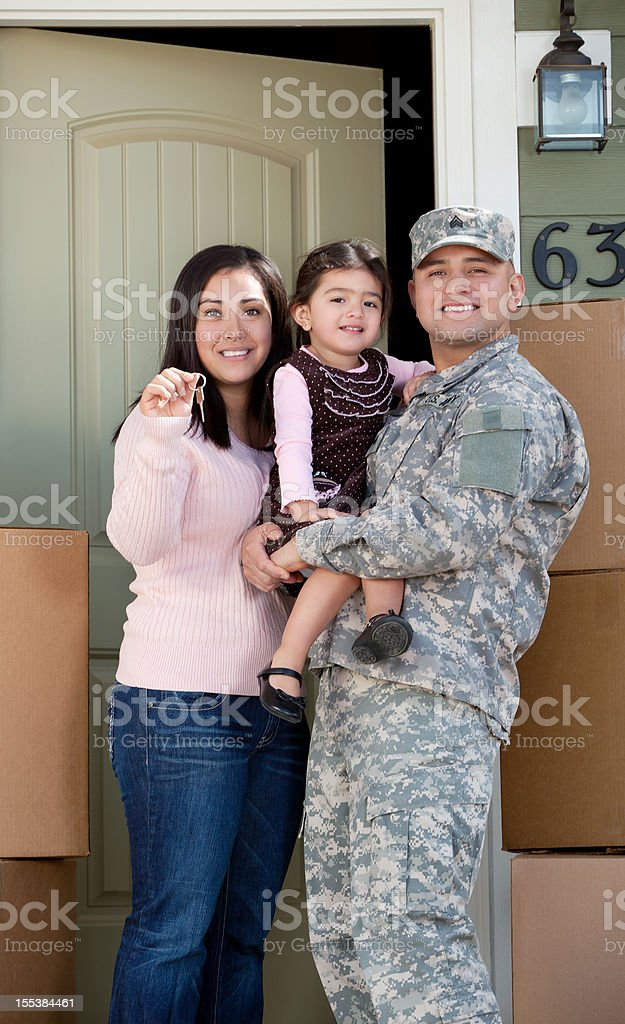 Real American soldier & Family Moving into New Home royalty-free stock photo