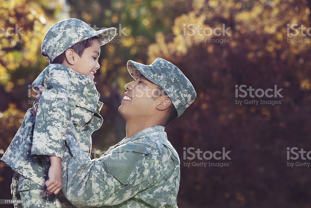 Real American Soldier & Son Outdoor Against Autumn Background stock photo
