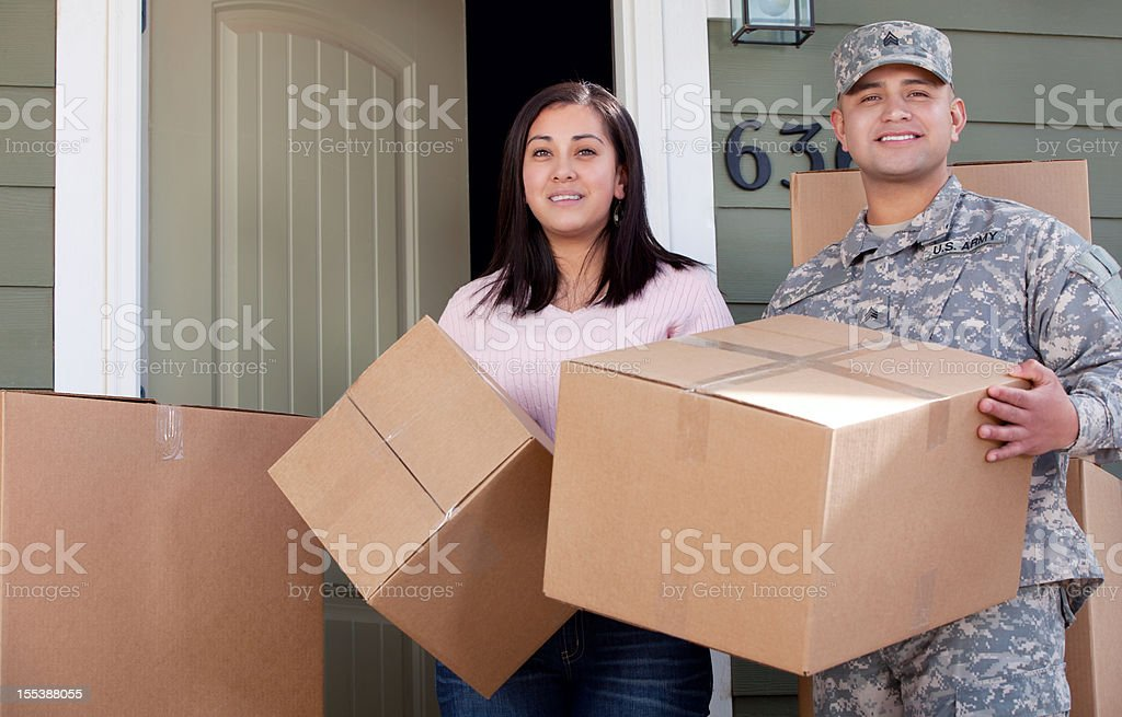 Real American soldier & Wife Moving into New Home royalty-free stock photo