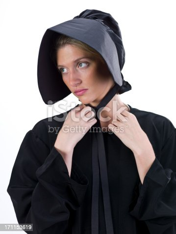 Real Amish young woman posing on white background (this picture have been shot with a Hasselblad HD3 II 31 megapixels)
