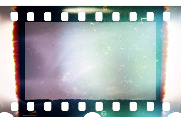 real and original 35mm or 135 film material or photo frame on white background, 35mm filmstrip with empty window or cell with dust, scratches and cool light effect - albuns fotografias recorte imagens e fotografias de stock