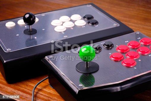 istock Real Arcade Joystick on Wood table 875168908