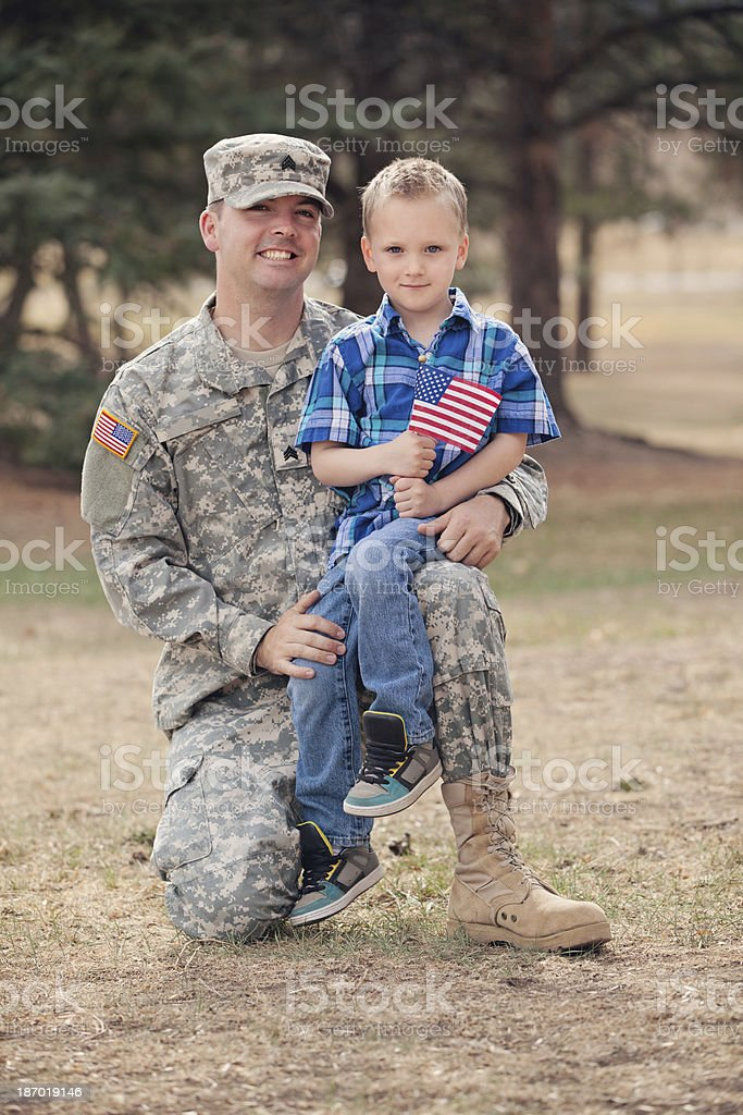 Real Army Soldier and Son Outdoor royalty-free stock photo