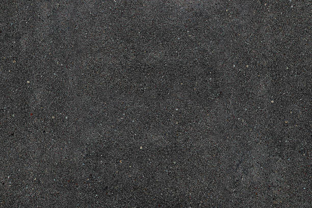 real asphalt texture background. coloured dark black asphalt pattern. - grainy stock photos and pictures