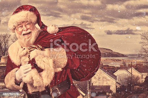 A real authentic Christmas photo of Santa Claus coming to town.