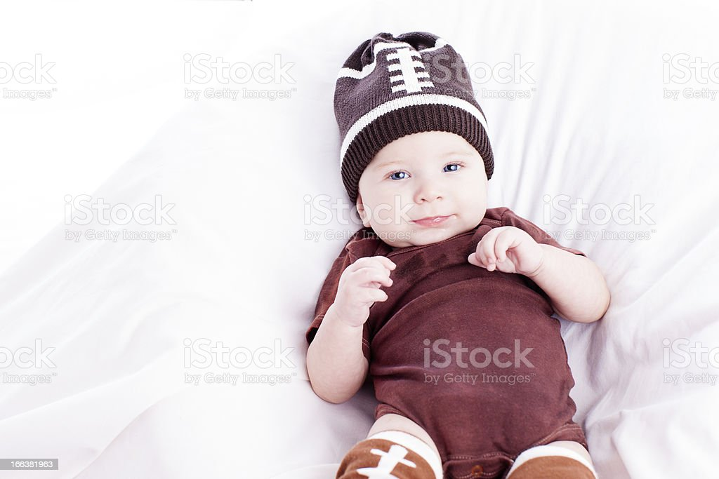 Real Babies: Baby Boy Dressed in American Football Costume stock photo