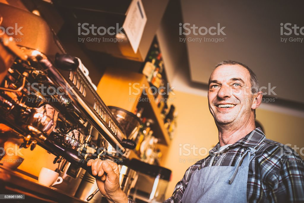 Real barmen at his coffee shop, Italy stock photo
