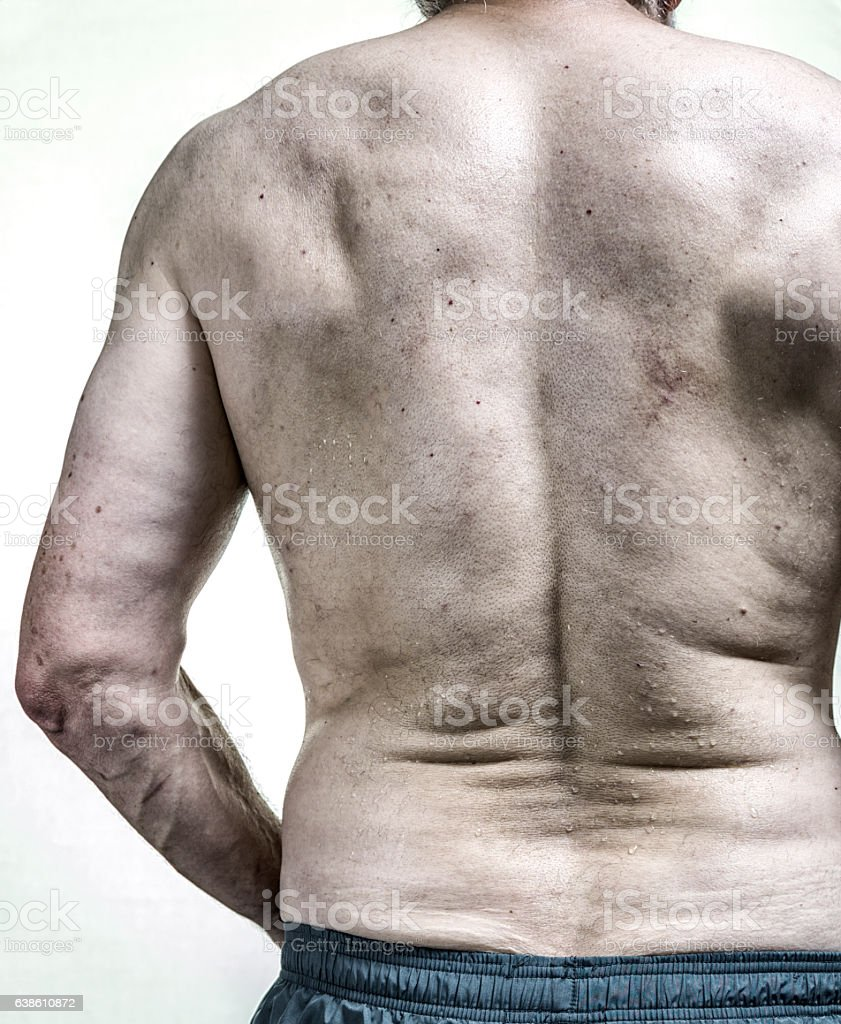 Real Body Senior Man Back Sweating After Gym Workout stock photo