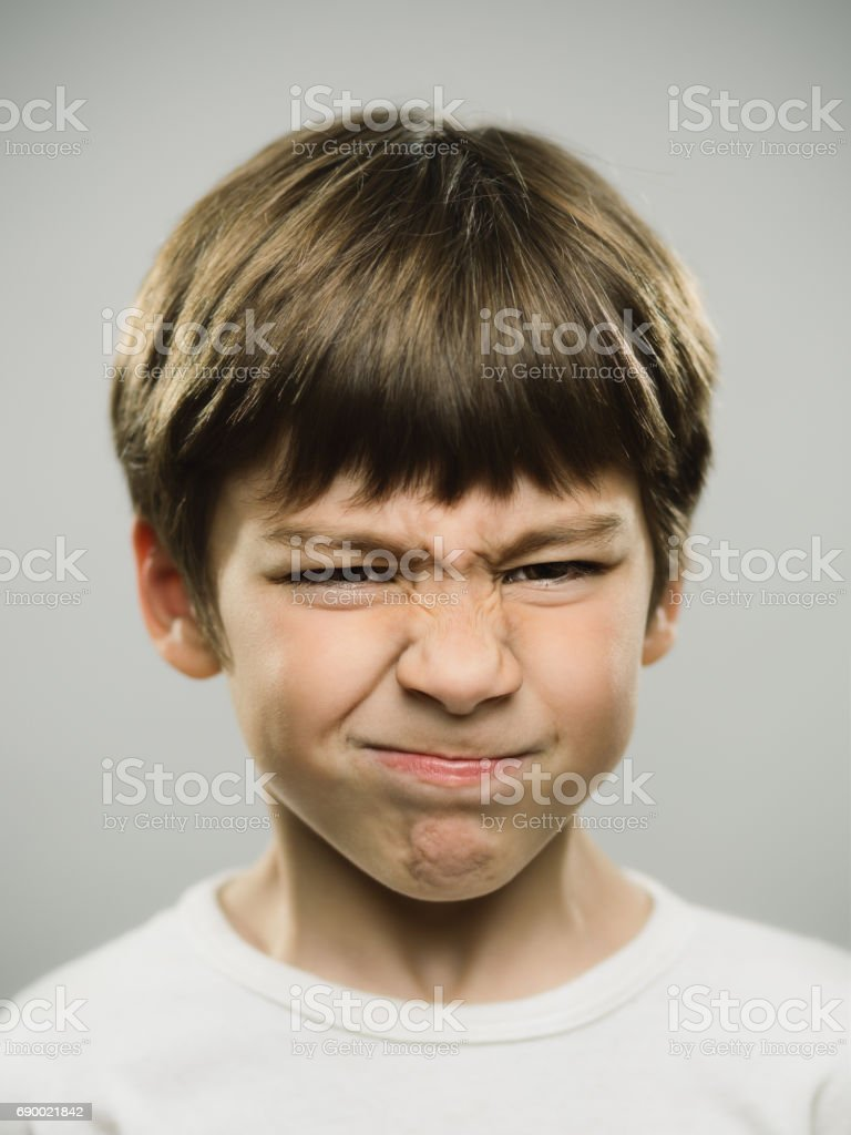 Real boy showing disgusted expression stock photo
