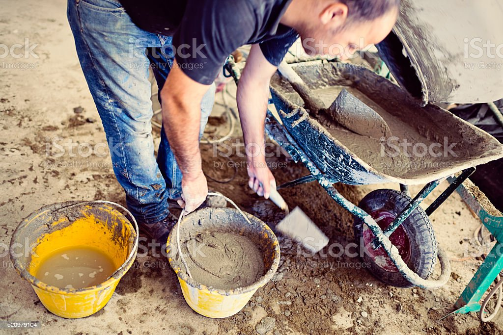 Real builder making cement stock photo