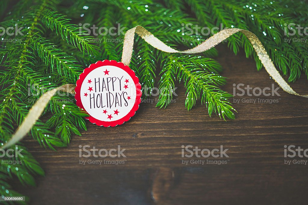 Real Christmas tree branches with holiday message stock photo