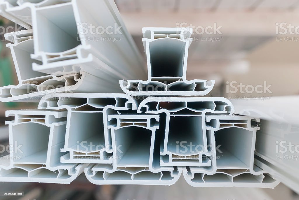 Real cut of the plastic PVC profile for windows manufacturing stock photo