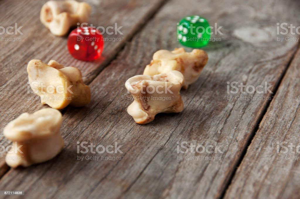 real dice knuckle bones and gaming pieces ancient game with lamb