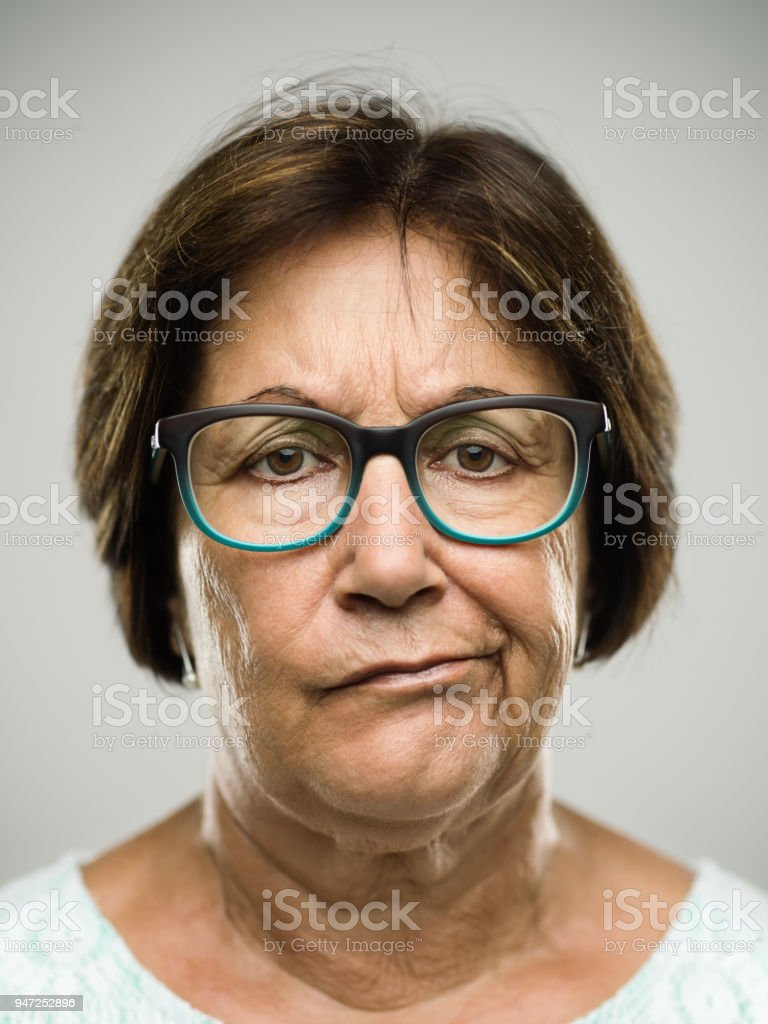 Real displeased senior woman portrait stock photo