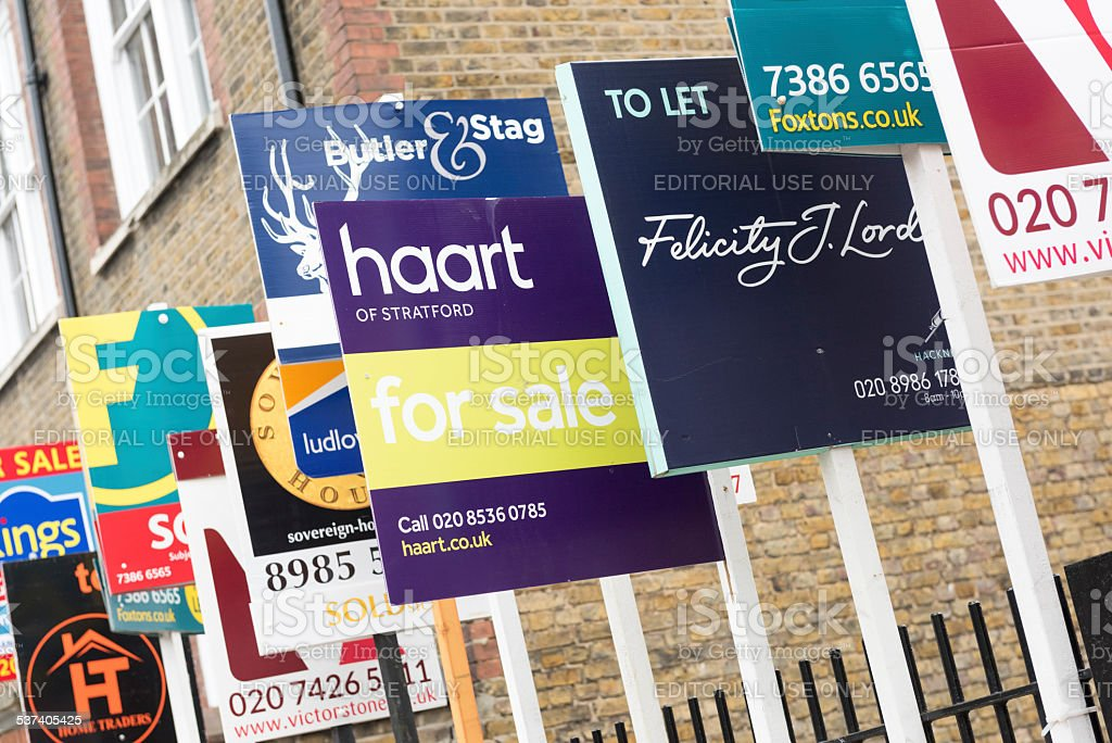 Real Estate Agency FOR SALE and TO LET sign boards stock photo