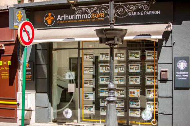 Real Estate Agency window display in Lourdes, France stock photo