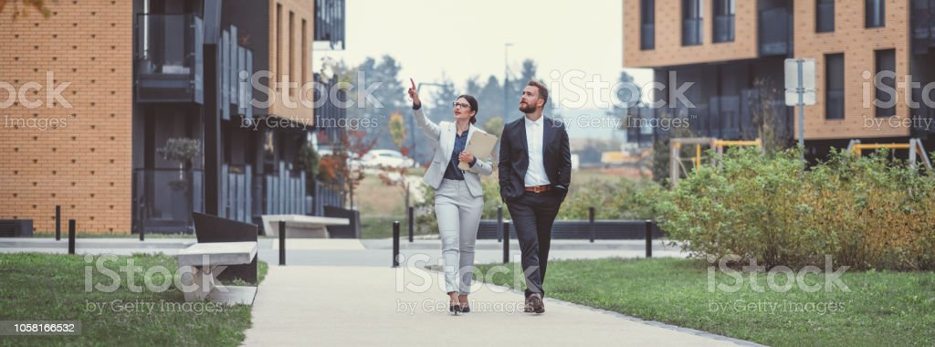 Real estate agent and businessman customer stock photo