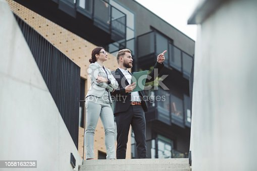 istock Real estate agent and businesswoman customer 1058163238