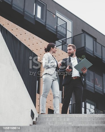 istock Real estate agent and businesswoman customer 1058168614