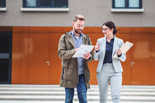istock Real estate agent and customer looking for apartment 1058168440