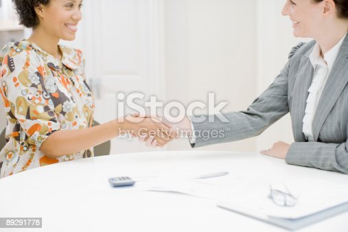istock Real estate agent and woman shaking hands 89291778
