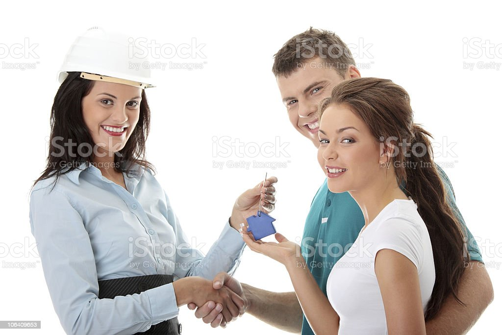 Real estate agent and young couple royalty-free stock photo