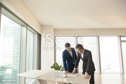 istock Real estate agent explaining room plan to client 845490500