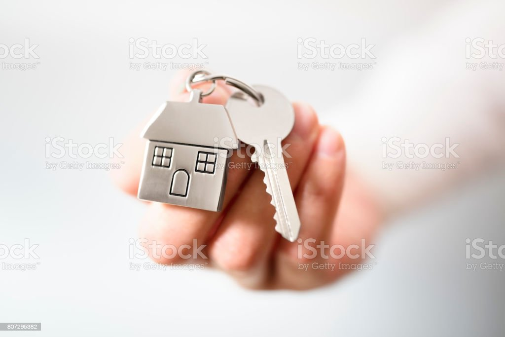 Real estate agent giving house keys royalty-free stock photo