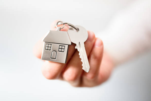 real estate agent giving house keys - house hunting stock photos and pictures