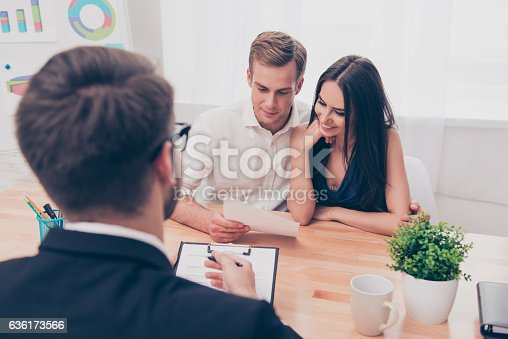 istock Real estate agent helping young family to buy flat 636173566