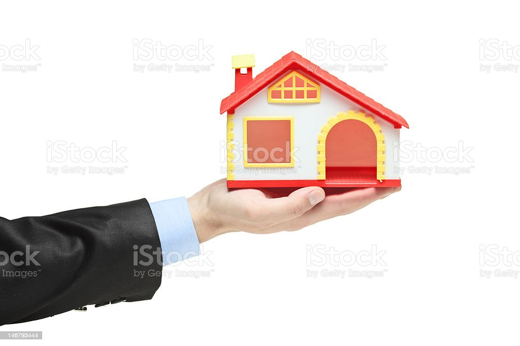 Real estate agent holding a model house royalty-free stock photo