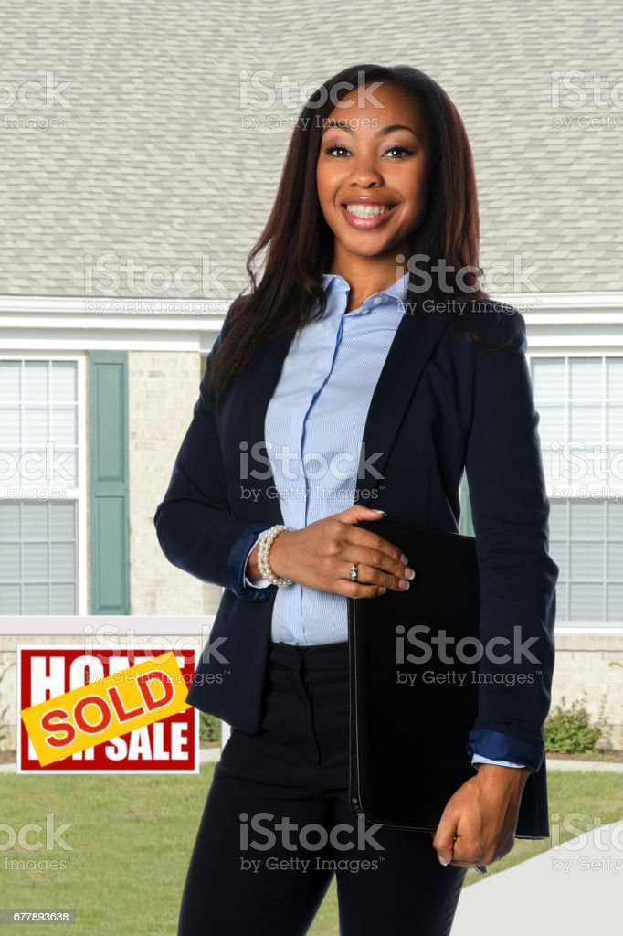 Real Estate Agent inf Front of Sold Home royalty-free stock photo
