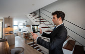 istock Real estate agent making a virtual tour of a house 1317532873