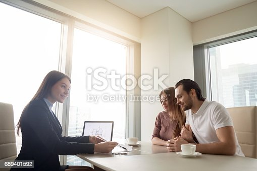 689401592 istock photo Real estate agent meeting with young couple, applying for mortgage 689401592