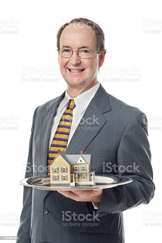 Real Estate Agent Offering a Residential Home on White Background royalty-free stock photo