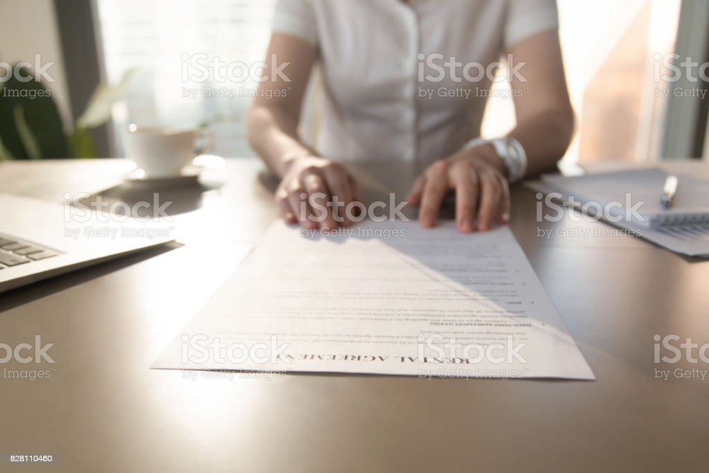 Real estate agent offers client to sign rental agreement, closeup stock photo