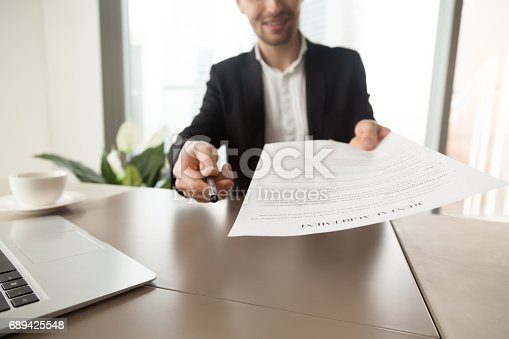 istock Real estate agent offers to sign rental agreement 689425548