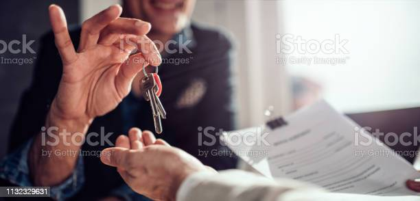 Real estate agent passing keys to his client picture id1132329631?b=1&k=6&m=1132329631&s=612x612&h=fij4vzepj akcf6jvrcoxtdo91hiy7t6asv4bjviefe=