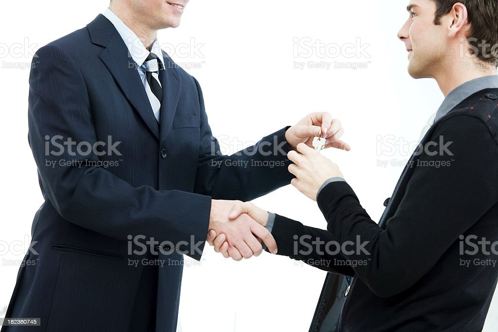 Real Estate Agent Passing Keys to New Home Buyer royalty-free stock photo